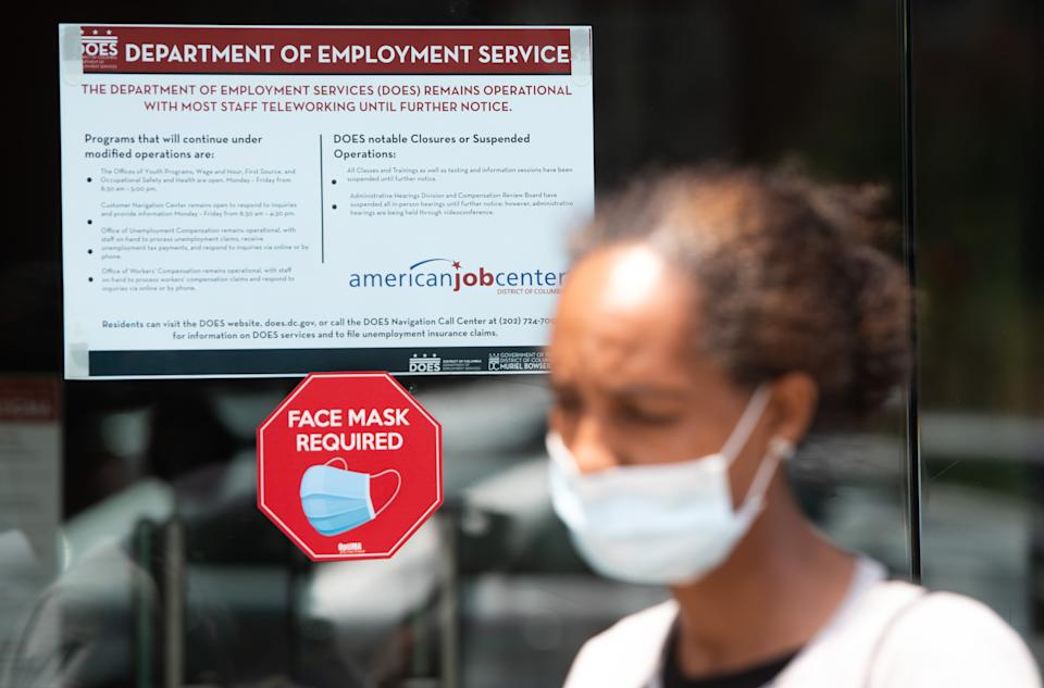 Diana Yitbarek, 44, of Washington, DC, leaves the DC Department of Employment Services, after trying to find out about her unemployment benefits in Washington, DC, July 16, 2020. - Americans worry as unemployment benefits are due to end soon. (Photo by SAUL LOEB / AFP) (Photo by SAUL LOEB/AFP via Getty Images)