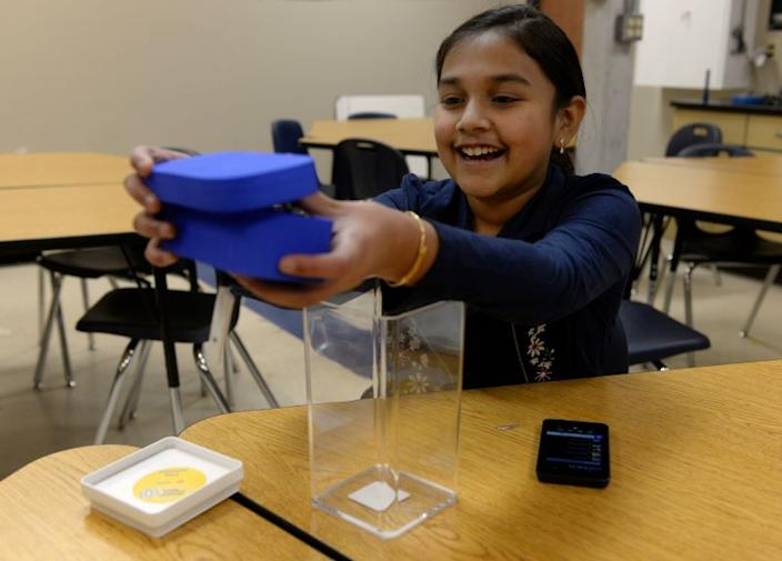 """Gitanjali Rao, 11, shows her """"Tethys"""" device at the STEM School Highlands Ranch on November 7, 2017 in Highlands Ranch, Colorado. Inspired by the Flint, MI water crisis, Gitanjali has been named Americas Top Young Scientist after she developed a device that quickly detects lead levels in water."""
