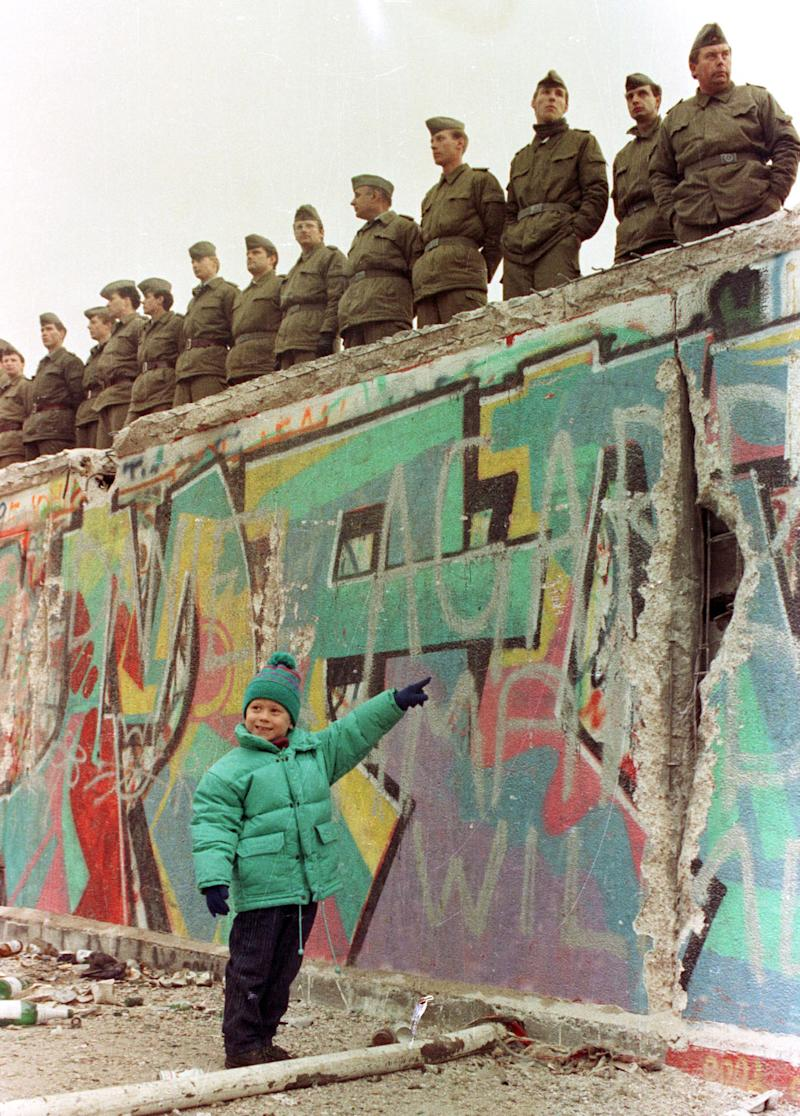 A young West German girl smiles at her father as she points to a large hole in the Berlin Wall in this Nov. 11, 1989. (Photo: Reuters)
