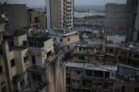 Damaged buildings are seen in a neighborhood near the site of last week's explosion that hit the seaport of Beirut, Lebanon, Tuesday, Aug. 11, 2020. (AP Photo/Felipe Dana)