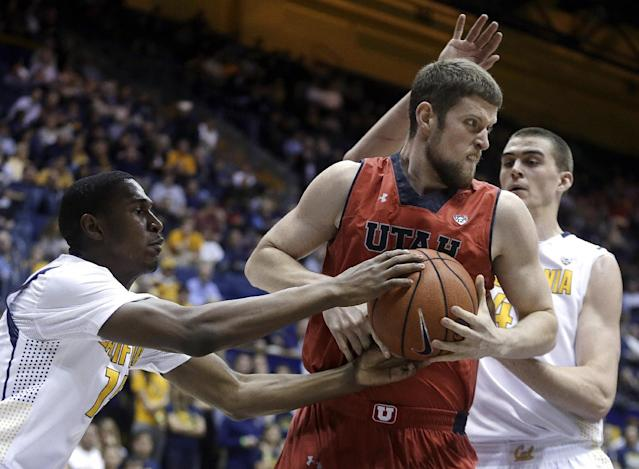 California's Jordan Mathews, left, and David Kravish, right, try to strip the ball from Utah's Renan Lenz during the first half of an NCAA college basketball game Wednesday, March 5, 2014, in Berkeley, Calif. (AP Photo/Ben Margot)