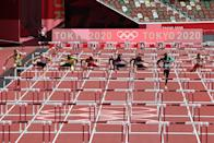 <p>Jamaica's Ronald Levy (3rd L) wins the men's 110m hurdles semi-final during the Tokyo 2020 Olympic Games at the Olympic Stadium in Tokyo on August 4, 2021. (Photo by Giuseppe CACACE / AFP)</p>