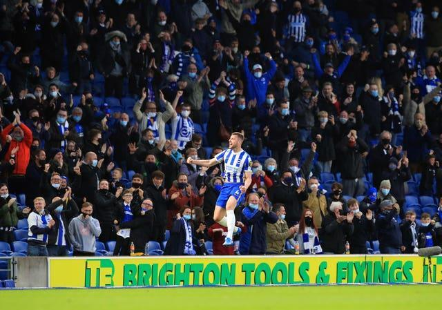 Brighton's Adam Webster celebrates scoring in front of home fans at the AMEX Stadium