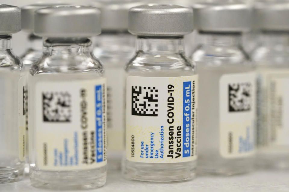 FILE - This Saturday, March 6, 2021, file photo shows vials of Johnson & Johnson COVID-19 vaccine at a pharmacy in Denver. Johnson & Johnson has asked U.S. regulators to allow booster shots of its COVID-19 vaccine as the U.S. government moves toward shoring up protection in more vaccinated Americans. J&J said Tuesday, Oct. 5, 2021, it filed data with the Food and Drug Administration on giving a booster dose between two to six months after vaccination. (AP Photo/David Zalubowski, File)