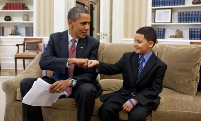 President Obama helps a little man out.