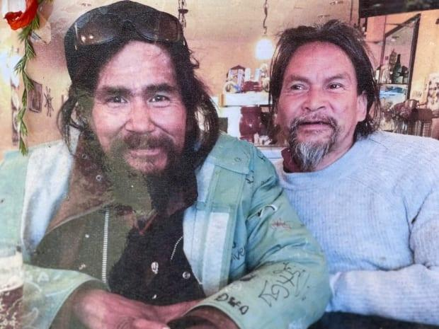A photo of Frank and Danse posted at their memorial on Commercial Drive in East Vancouver. (Karin Larsen/CBC - image credit)