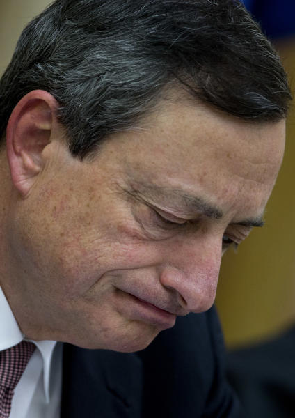 """European Central Bank President Mario Draghi pauses during a news conference inside the Spanish parliament, Madrid, Spain, Tuesday, Feb. 12, 2013. Draghi, who earlier met with Spanish political party representatives in Parliament during a closed-door session said it is """"inappropriate"""" and """"fruitless"""" for politicians to push the ECB to influence the euro's exchange rate. The ECB is forbidden by treaty from taking instructions from politicians. Draghi says the bank doesn't target any particular exchange rate but is monitoring the stronger euro's effects on the economy. (AP Photo/Paul White)"""