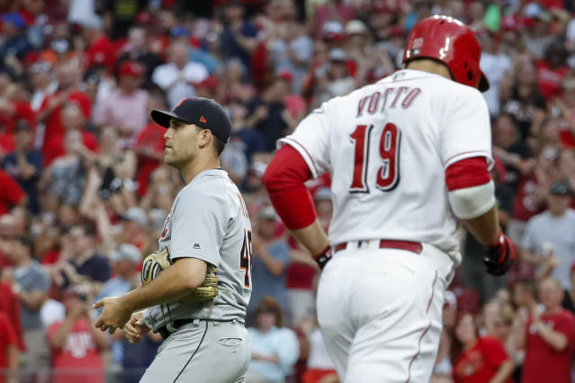 Detroit Tigers starting pitcher Matthew Boyd, left, walks back to the mound after giving up a grand slam to Cincinnati Reds' Joey Votto (19) during the third inning of a baseball game Tuesday, June 19, 2018, in Cincinnati. (AP Photo/John Minchillo)