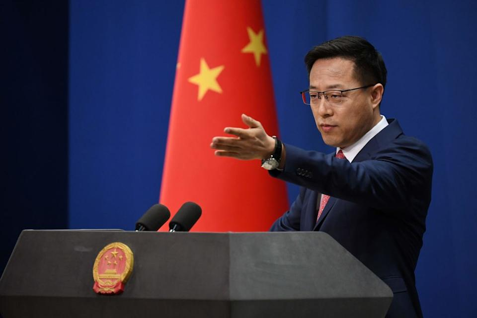 Chinese Foreign Ministry spokesman Zhao Lijian pointing at a journalist.