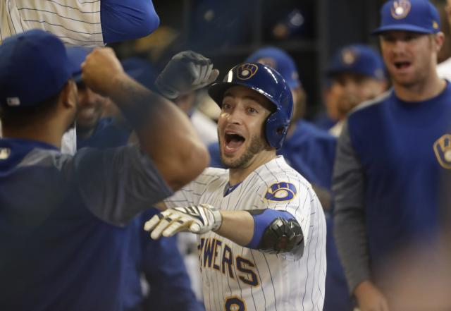 Milwaukee Brewers' Ryan Braun celebrates his home run during the eighth inning of a baseball game against the Detroit Tigers Friday, Sept. 28, 2018, in Milwaukee. (AP Photo/Morry Gash)