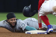 Seattle Mariners' J.P. Crawford is tagged out at second by Texas Rangers second baseman Nick Solak on an attempted steal during the sixth inning of a baseball game Friday, May 7, 2021, in Arlington, Texas. (AP Photo/Richard W. Rodriguez)