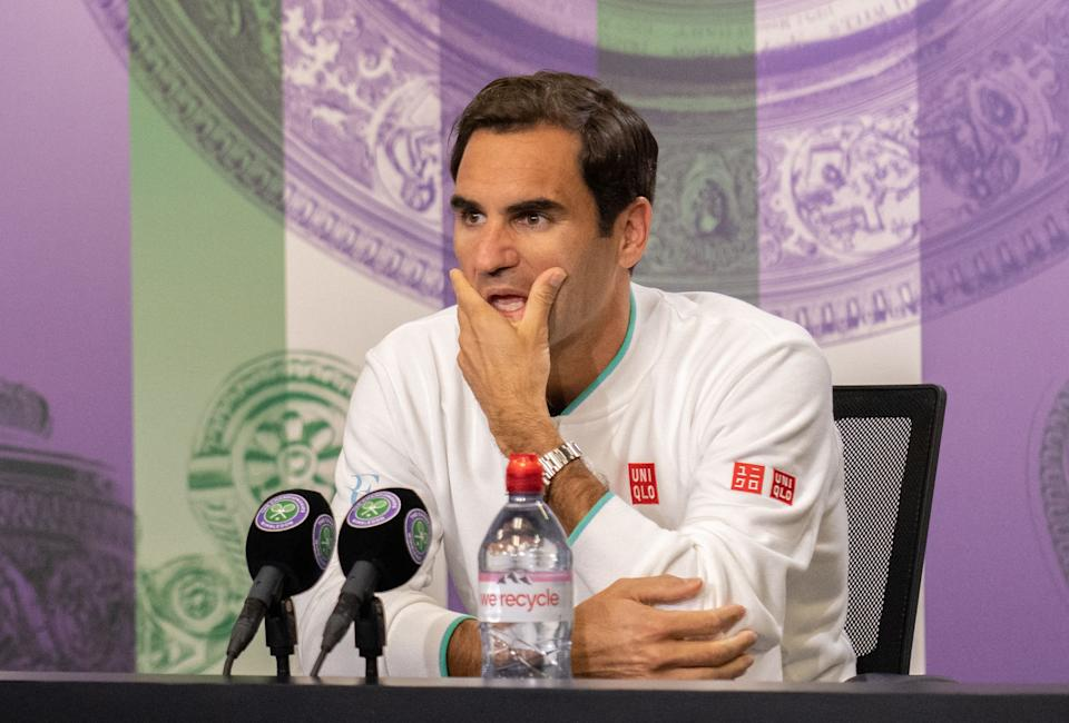Roger Federer (pictured) attends a press conference after losing to Hubert Hurkacz during their men's quarter-finals match at Wimbledon.