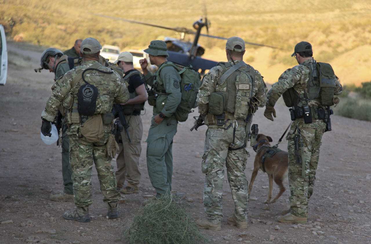 In this photo provided by U.S. Customs and Border Protection, law enforcement officers gather at a command post in the desert near Naco, Ariz., Tuesday, Oct. 2, 2012, after a Border Patrol agent was shot to death near the U.S.-Mexico line. The agent, Nicholas Ivie, 30, and a colleague were on patrol about 100 miles from Tucson, when shooting broke out shortly before 2 a.m., the Border Patrol said. (AP Photo/U.S. Customs and Border Protection, Gabriel Guerrero)