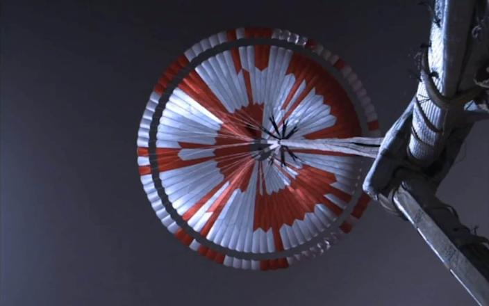 The parachute is deployed, seen here from a camera looking upwards from the back shell, before the descent stage releases the rover. - Nasa