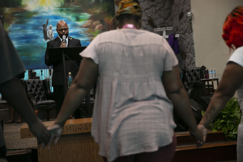 The Rev. Marcus Murchinson leads a prayer during a Sunday service at Tree of Life Missionary Baptist Church Sunday, June 21, 2020, in the Watts neighborhood of Los Angeles. Churches are the heart of the Black community, Murchinson said. In addition to ministering to the faithful, churches provide food, clothing and recreation programs for children. Murchinson also runs a charter school and drug rehab clinics. (AP Photo/Jae C. Hong)