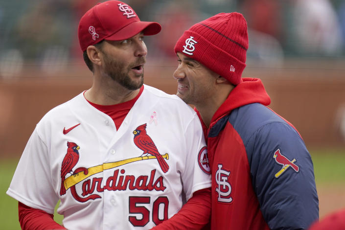 St. Louis Cardinals starting pitcher Adam Wainwright (50) celebrates with teammate Jack Flaherty following a 2-0 victory over the Colorado Rockies in a baseball game Sunday, May 9, 2021, in St. Louis. (AP Photo/Jeff Roberson)