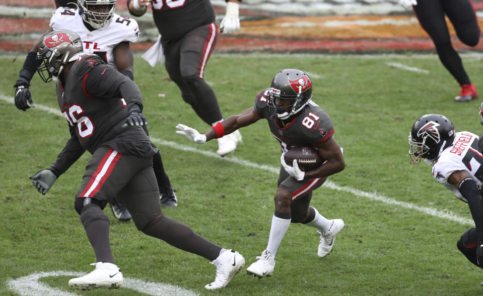 Tampa Bay Buccaneers wide receiver Antonio Brown (81) follows a block by offensive tackle Donovan Smith (76) during the second half of an NFL football game against the Atlanta Falcons Sunday, Jan. 3, 2021, in Tampa, Fla. (AP Photo/Mark LoMoglio)