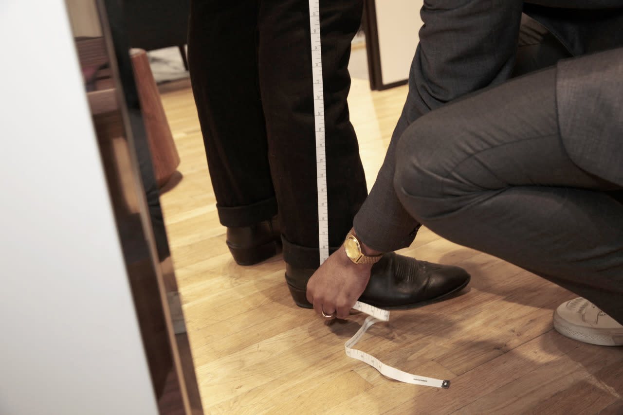 <p>Quinn normally wears cowboy boots, which Brocket takes into account for his fitting. Indochino also gives you the option to add pleats, suspender buttons, and belt loops to the bottom half of your suit. (Try cropped pants, if you want to be extra stylish!) (Photo: Alexis Brooks for Yahoo Style)</p>