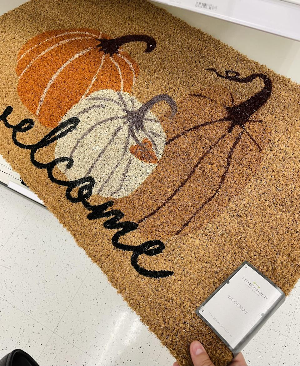 <p>I can't believe how affordable this <span>Threshold Three Pumpkins Welcome Harvest Doormat</span> ($13) is - it looks like it should be at least $40. It's an easy way to give your home a quick seasonal update.</p>
