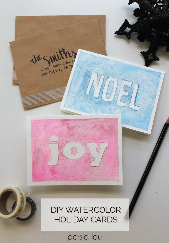 """<p>Though undoubtedly elegant, you really don't need any artistic skills to create these DIY Christmas cards. Simply paint around letter stickers, then peel them up to reveal a nice, crisp message. </p><p><em>Get the tutorial at <a href=""""https://persialou.com/homemade-watercolor-christmas-cards-at/"""" rel=""""nofollow noopener"""" target=""""_blank"""" data-ylk=""""slk:Persia Lou"""" class=""""link rapid-noclick-resp"""">Persia Lou</a>.</em> </p><p><a class=""""link rapid-noclick-resp"""" href=""""https://www.amazon.com/JAMEGIO-Colorful-Stickers-Cardstock-Alphabet/dp/B07YBRCWLV/?tag=syn-yahoo-20&ascsubtag=%5Bartid%7C10072.g.34351112%5Bsrc%7Cyahoo-us"""" rel=""""nofollow noopener"""" target=""""_blank"""" data-ylk=""""slk:SHOP LETTER STICKERS"""">SHOP LETTER STICKERS</a></p>"""
