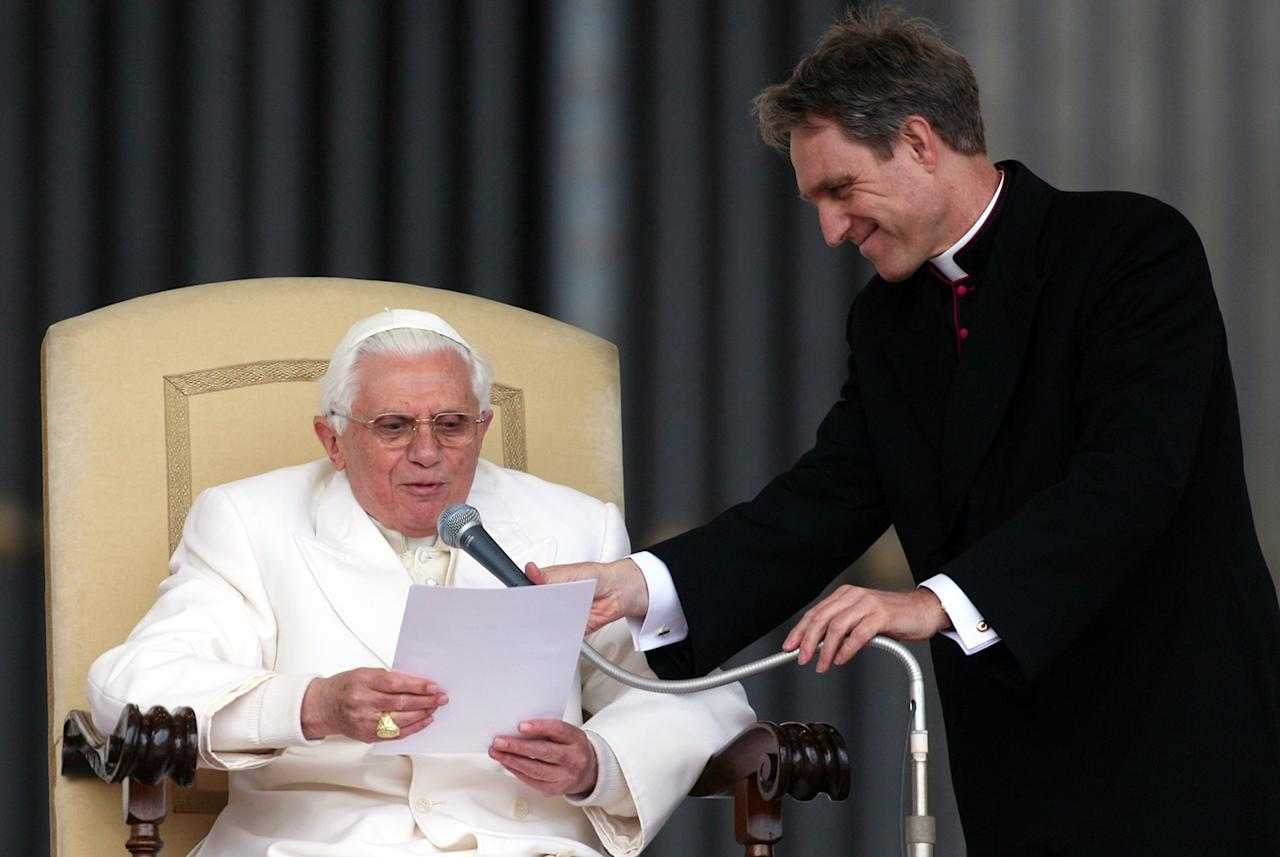 Pope Benedict XVI, assisted by his personal secretary Georg Ganswein, attends his weekly audience at Saint Peter's Square March 21, 2007 in Vatican City.  (Photo by Franco Origlia/Getty Images)