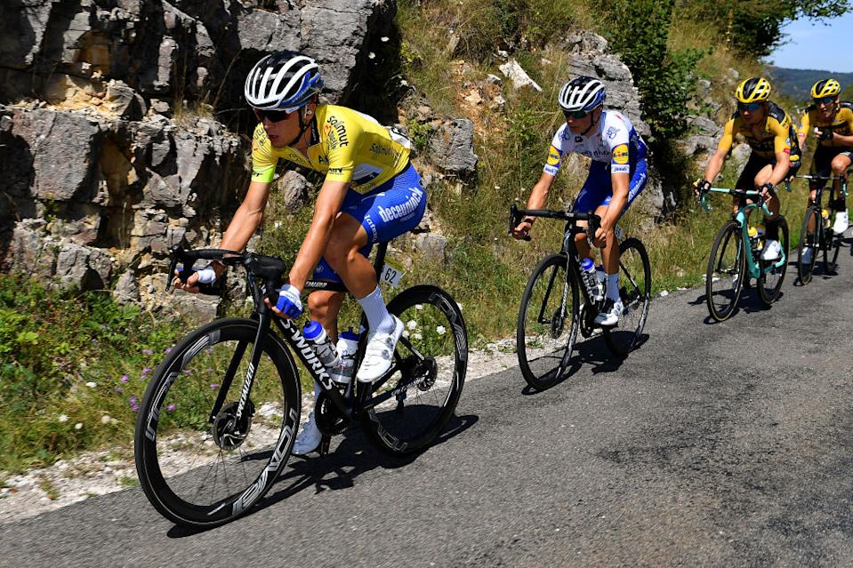 SAINTVULBAS FRANCE  AUGUST 08 Andrea Bagioli of Italy and Team Deceuninck  QuickStep Yellow Leader Jersey  Mauri Vansevenant of Belgium and Team Deceuninck  QuickStep  Tony Martin of Germany and Team Jumbo  Visma  during the 32nd Tour de LAin 2020 Stage 2 a 141km stage from Lagnieu to Llex MontsJura 896m  tourdelain  TOURDELAIN  TDA  on August 08 2020 in SaintVulbas France Photo by Justin SetterfieldGetty Images