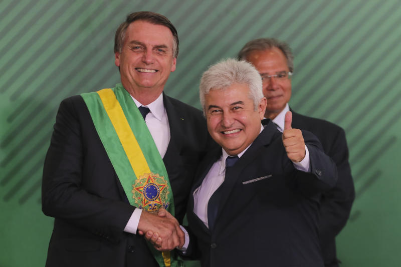 Brazil's new President Jair Bolsonaro (L) shakes hands with Brazil's new Minister of Science and Technology Marcos Pontes during the swearing-in ceremony of his cabinet at Planalto Palace in Brasilia on January 1, 2019 after his own inauguration ceremony at the National Congress. - Bolsonaro takes office with promises to radically change the path taken by Latin America's biggest country by trashing decades of centre-left policies. (Photo by Sergio LIMA / AFP) (Photo credit should read SERGIO LIMA/AFP/Getty Images)