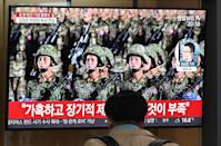 A man watches a television news broadcast of a military parade commemorating the 75th anniversary of North Korea's ruling Workers' Party held in Pyongyang, at a railway station in Seoul on October 10, 2020. - Nuclear-armed North Korea held a giant military parade on October 10, television images showed, with thousands of maskless troops defying the coronavirus threat and Pyongyang expected to put on show its latest and most advanced weapons. (Photo by Jung Yeon-je / AFP) (Photo by JUNG YEON-JE/AFP via Getty Images)