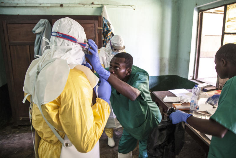 In this photo taken Saturday, May 12, 2018, health workers don protective clothing as they prepare to attend to patients in the isolation ward to diagnose and treat suspected Ebola patients, at Bikoro Hospital in Bikoro, the rural area where the Ebola outbreak was announced last week, in Congo. Congo's latest Ebola outbreak has now spread to Mbandaka, a city of more than 1 million people, a worrying shift as the deadly virus risks traveling more easily in densely populated areas. (Mark Naftalin/UNICEF via AP)
