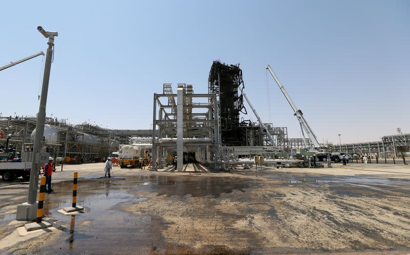 FILE PHOTO: Workers are seen at the damaged site of Saudi Aramco oil facility in Khurais