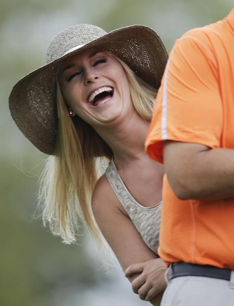 Skier Lindsey Vonn laughs while watching Tiger Woods during the first round of the Masters golf tournament Thursday, April 11, 2013, in Augusta, Ga. (AP Photo/Darron Cummings)