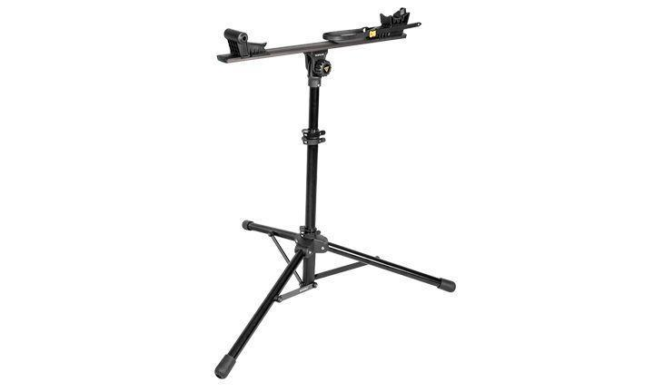 """<p>topeak.com</p><p><strong>$269.95</strong></p><p><a href=""""https://www.topeak.com/us/en/products/39-Stands/1176-prepstand--x"""" rel=""""nofollow noopener"""" target=""""_blank"""" data-ylk=""""slk:Shop Now"""" class=""""link rapid-noclick-resp"""">Shop Now</a></p><p>This stand is the lightest and one of the most compact that we've tested—great to throw into the back of your car for race-day repairs and road trips. The main beam slides forward and back, as well as up and down, handy for performing brake bleeds. Like other Euro-style stands, this one can rotate 360 degrees and does it so smoothly that you'd think it was turning on bearings.</p>"""