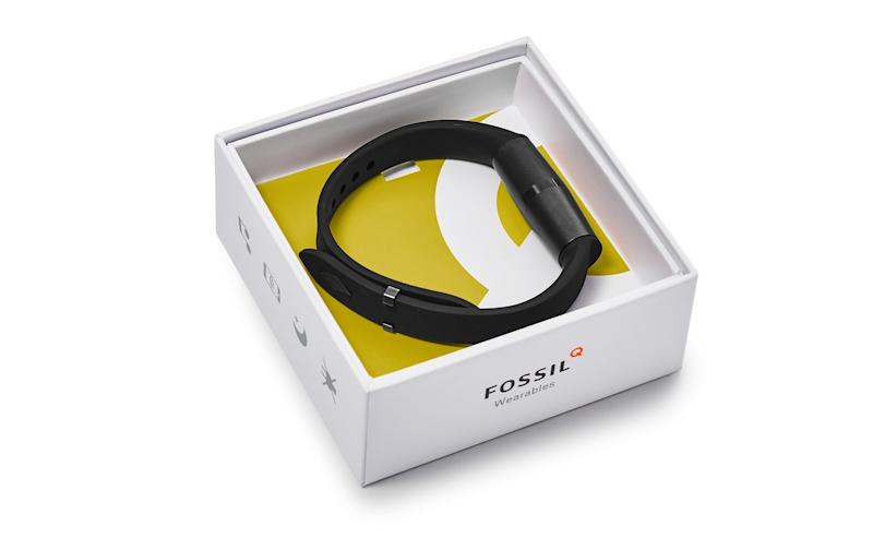 Wearable device in a white and yellow box with Fossil's logo.