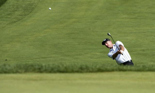 Jim Furyk chips on to the sixth green during the third round of the Canadian Open golf championship at the Royal Montreal Golf Club in Montreal, Saturday, July 26, 2014. (AP Photo/The Canadian Press, Paul Chiasson)