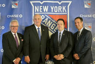 FILE - in this Wednesday, May 22, 2019, file photo, John Davidson, the new president of the New York Rangers, second from left, poses for a picture with adviser to the owner, Glen Sather, left, general manager Jeff Gorton, second from right, and coach David Quinn during a news conference in New York. The New York Rangers abruptly fired president John Davidson and general manager Jeff Gorton on Wednesday, May 5, 2021 with three games left in the season. Chris Drury was named president and GM. He previously served as associate GM under Davidson and Gorton. (AP Photo/Seth Wenig)