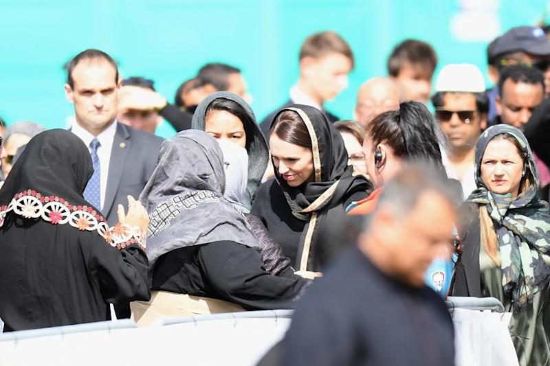 New Zealand Prime Minister Jacinda Ardern greets members of the Muslim community as she attends islamic prayers in Hagley Park (Getty Images)
