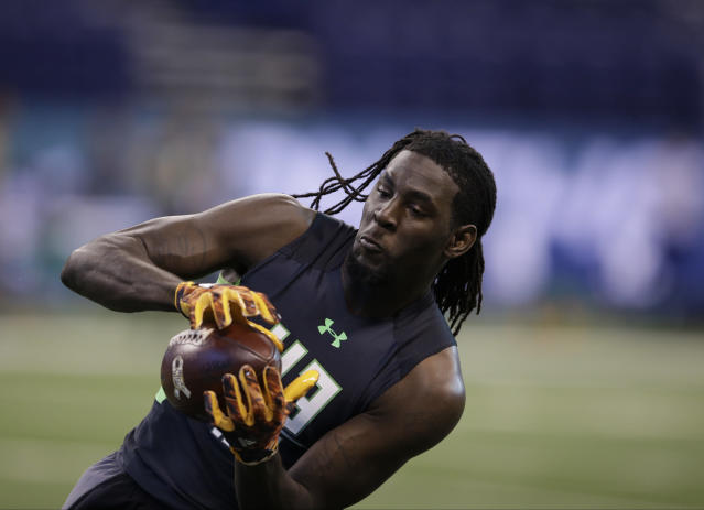 Mississippi State receiver De'Runnya Wilson runs a drill at the NFL football scouting combine on Saturday, Feb. 27, 2016, in Indianapolis. (AP Photo/Darron Cummings)