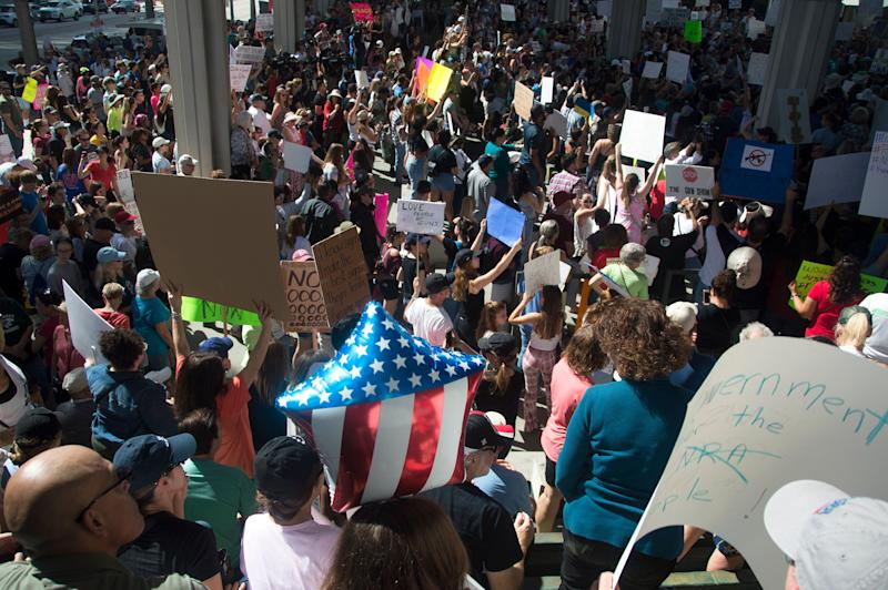 People gathered at the Fort Lauderdale federal courthouse on Feb. 17, 2018, to call for gun control in the wake of the deadly high school shooting in Parkland, Florida.