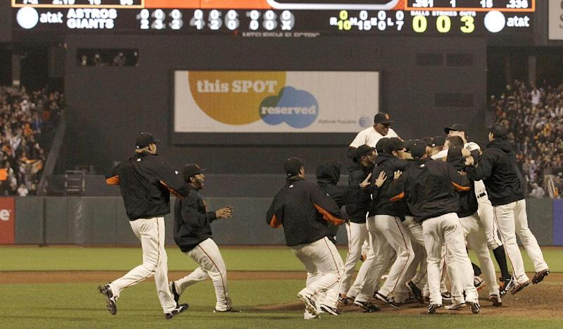 San Francisco Giants players celebrate after pitcher Matt Cain pitched a perfect game in a baseball game against the Houston Astros in San Francisco, Wednesday, June 13, 2012. Cain pitched the 22nd perfect game in major league history and first for the Giants, striking out a career-high 14 and getting help from two spectacular catches to beat the Houston Astros 10-0. (AP Photo/Jeff Chiu)