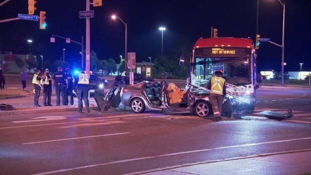 A man is dead after his car collided with a TTC bus at Port Union Road and Kingston Road shortly after 1:30 a.m. Sunday, police say. (Jeremy Cohn - image credit)