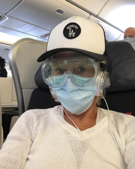 Helen Mirren dons goggles and a mask on a flight during the COVID-19 pandemic