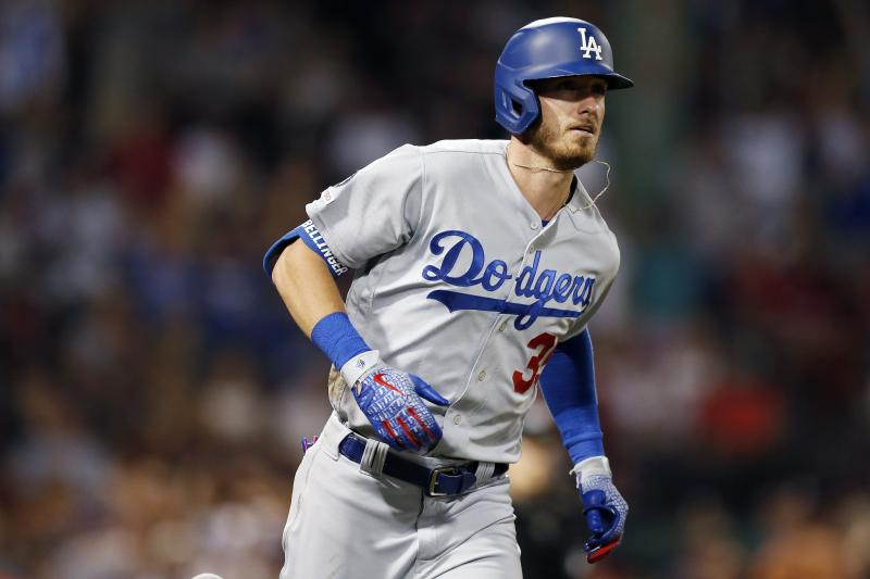 Los Angeles Dodgers' Cody Bellinger runs on his solo home run during the seventh inning of a baseball game against the Boston Red Sox in Boston, Saturday, July 13, 2019. (AP Photo/Michael Dwyer)