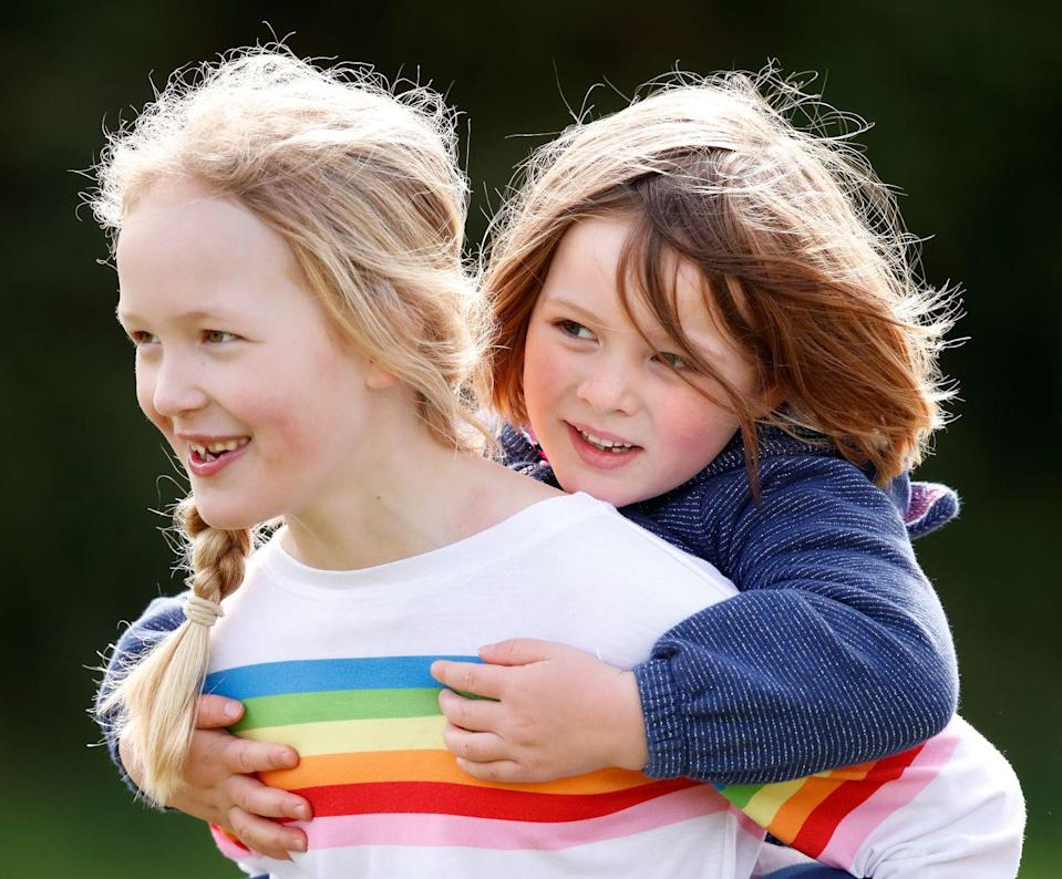 <p>Princess Anne's granddaughter Savanah Phillips gave her cousin Mia Tindall a piggyback ride at the Gatcombe Horse Trials.</p>