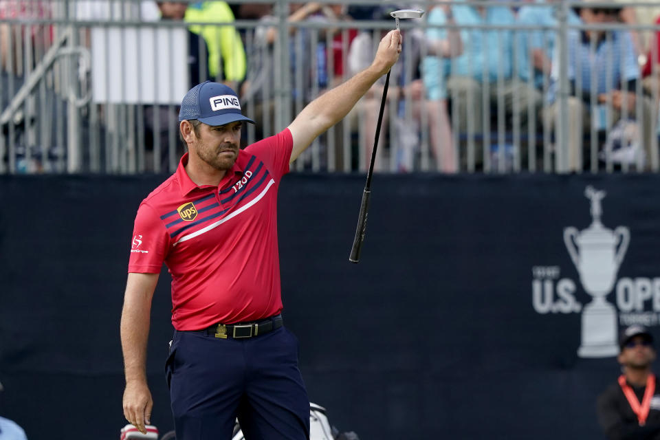 Louis Oosthuizen, of South Africa, reacts to making his eagle putt on the 18th green during the third round of the U.S. Open Golf Championship, Saturday, June 19, 2021, at Torrey Pines Golf Course in San Diego. (AP Photo/Marcio Jose Sanchez)