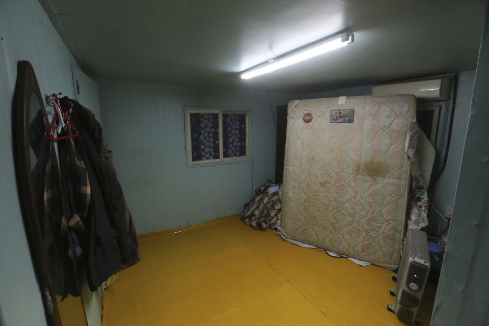 This photo shows clothes and a mattress of migrant workers in a shipping container, a makeshift home for them at a farm in Pocheon, South Korea on Feb. 8, 2021. Amid a sea of greenhouses near South Korea's ultra-modern capital, hundreds of migrant workers from across Asia toil isolated and unprotected by labor laws. (AP Photo/Ahn Young-joon)