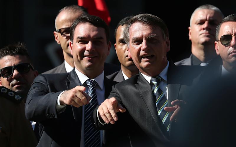 Brazilian President Jair Bolsonaro and his son and Senator Flavio Bolsonaro (L) attend a ceremony to celebrate the 130th anniversary of the Military School in Rio de Janeiro, Brazil May 6, 2019. REUTERS/Ricardo Moraes