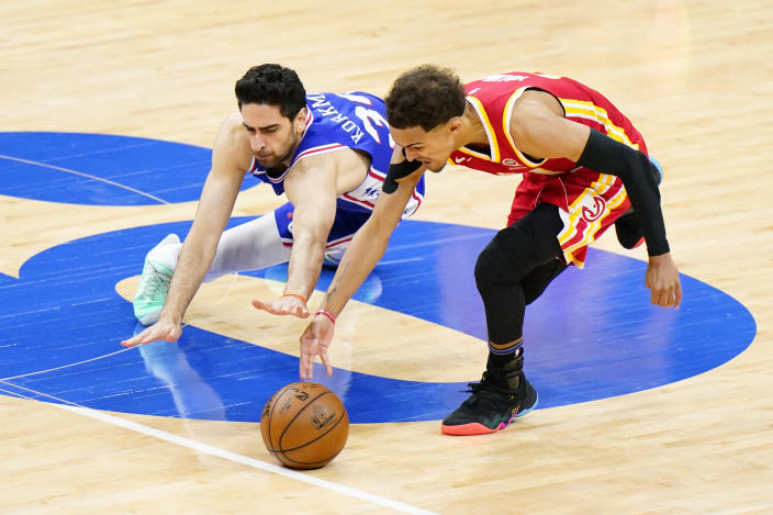 Atlanta Hawks' Trae Young, right, and Philadelphia 76ers' Furkan Korkmaz chase down a loose ball during the second half of Game 5 in a second-round NBA basketball playoff series, Wednesday, June 16, 2021, in Philadelphia. (AP Photo/Matt Slocum)