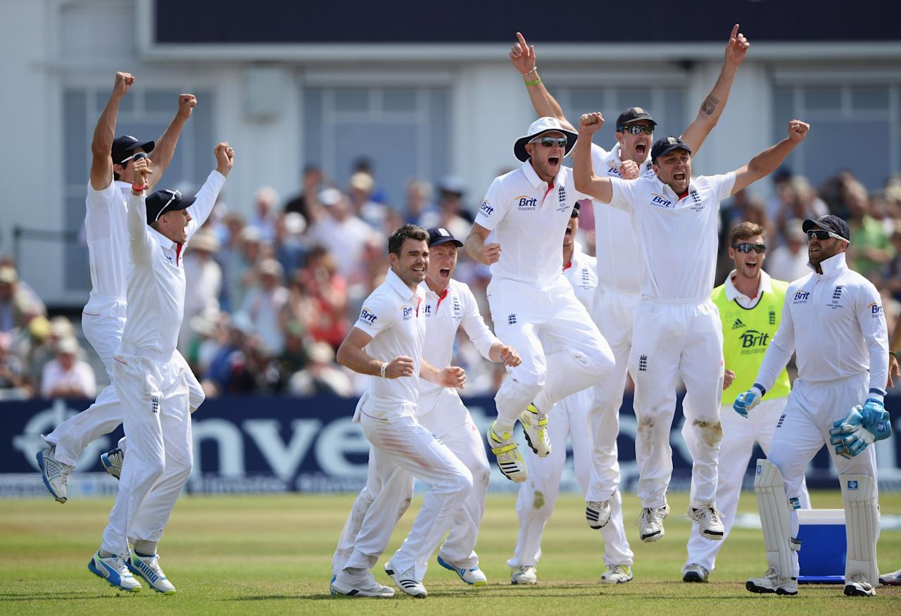 NOTTINGHAM, ENGLAND - JULY 14: James Anderson of England celebrates the final wicket of Brad Haddin of Australia and victory with team mates during day five of the 1st Investec Ashes Test match between England and Australia at Trent Bridge Cricket Ground on July 14, 2013 in Nottingham, England. (Photo by Gareth Copley/Getty Images)