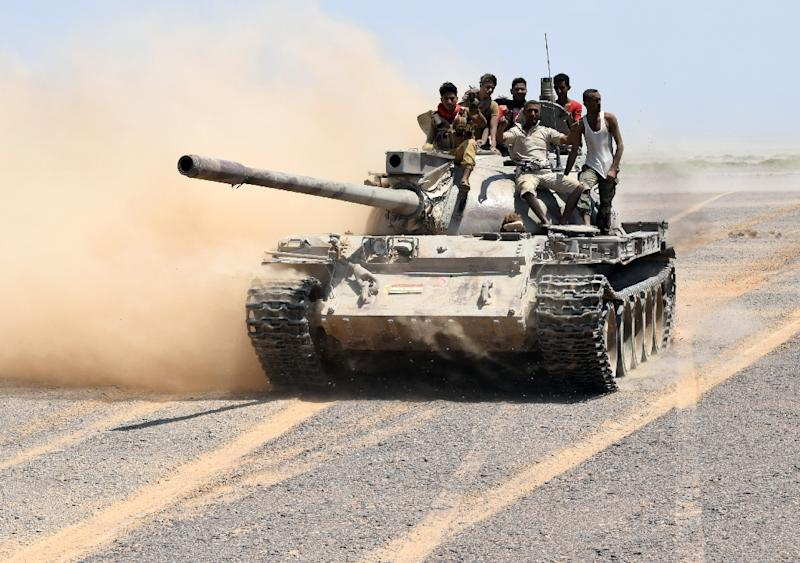 Fighters loyal to Yemeni President Abedrabbo Mansour Hadi drive a tank in the area of the strategic Bab al-Mandab Strait, in the southern province of Taez, on October 1, 2015