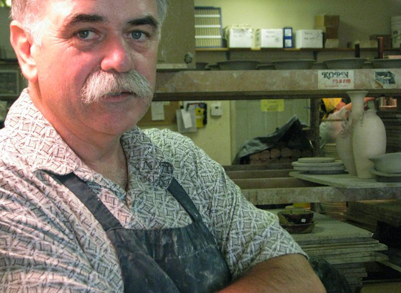 This June 7, 2012, photo shows artist Steve Ayers in his shop in Hannibal, Mo. When Ayers opened his pottery shop in 1985 he was about the only artist in the riverfront town known mostly for its favorite son, Mark Twain. Twain still is the main draw for the half-million tourists who visit Hannibal each year, but now they get a bonus: A growing number of artists, many of national and international repute. (AP Photo/The Courier-Post, Mary Lou Montgomery)